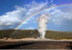 Rainbow over Old Faithful