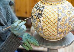 Painting a ceramic vase