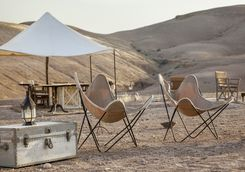 Chairs in the desert at Scarabeo Stone Desert Camp