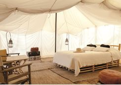 Inside of a tent at Scarabeo Desert Camp