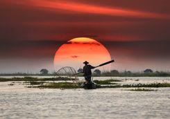Fisherman at sunset on Inle Lake
