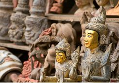 Carved wooden statutes
