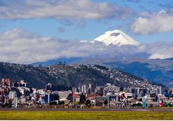 a view of Quito with a volcano in the background