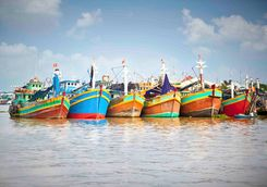 fishing boats on the mekong delta