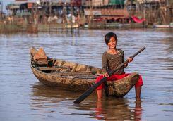 Girl in boat on Tonle Sap lake