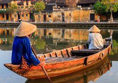 Women in boat in Hoi An