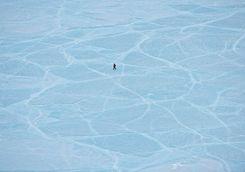 walking across frozen lake