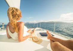 Couple relaxing on a catamaran