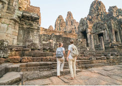 Couple of tourist in front of a temple