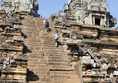 People climbing Ta Keo temple