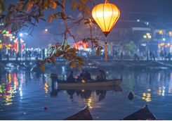 Colourful lantern over rowboats