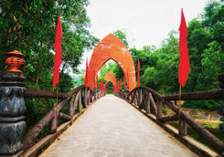 bridge with flags at old hindu temples