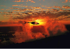 Helicopter over the Victoria Falls at sunset