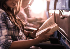 women reading in a plane