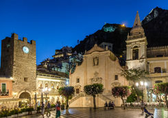 Taormina main square with San Giuseppe church and the Clock tower at night