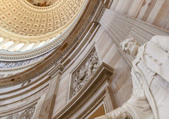 Capitol building rotunda with a sculpture of Abraham Lincoln