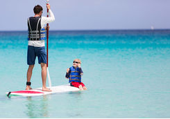 Paddleboarding father and son