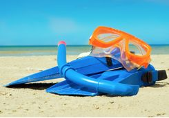 mask and flippers on beach