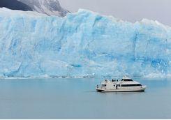 tourist boat at perito moreno glacier