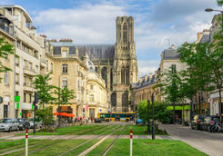 Tram on the streets and architecture of Reims
