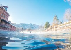 Swimming in outdoor hot springs pool