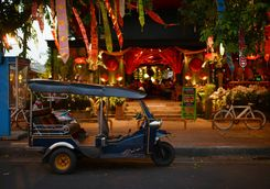 tuk tuk parked in front of a restaurant