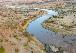 Mara river winding across the Serengeti savanna in Tanzania