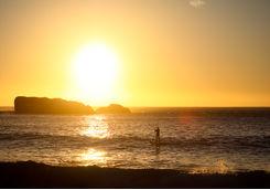 Paddle boarding on sunset