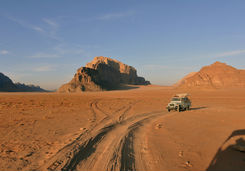 Car in Wadi Rum with Rock Formations