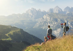 Teenagers taking a break during trail in the Dolomites