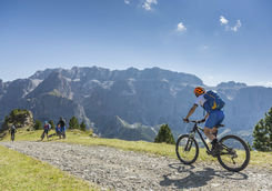 Mountain biker is joining mountain bikers on a ride in the Dolomites