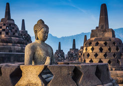 Ancient buddha statue and stupa at Borobudur Temple