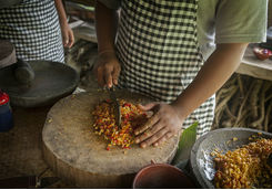 Man preparing food on a Balinese cooking class