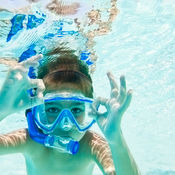 Boy snorkelling on family holiday