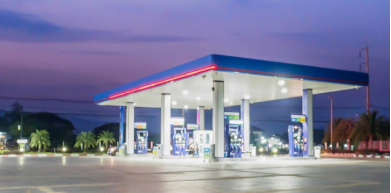 A photo of a well-lit service station in the evening