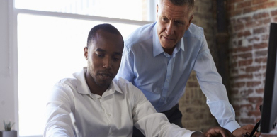 A photo of a business person receiving advice from a mentor
