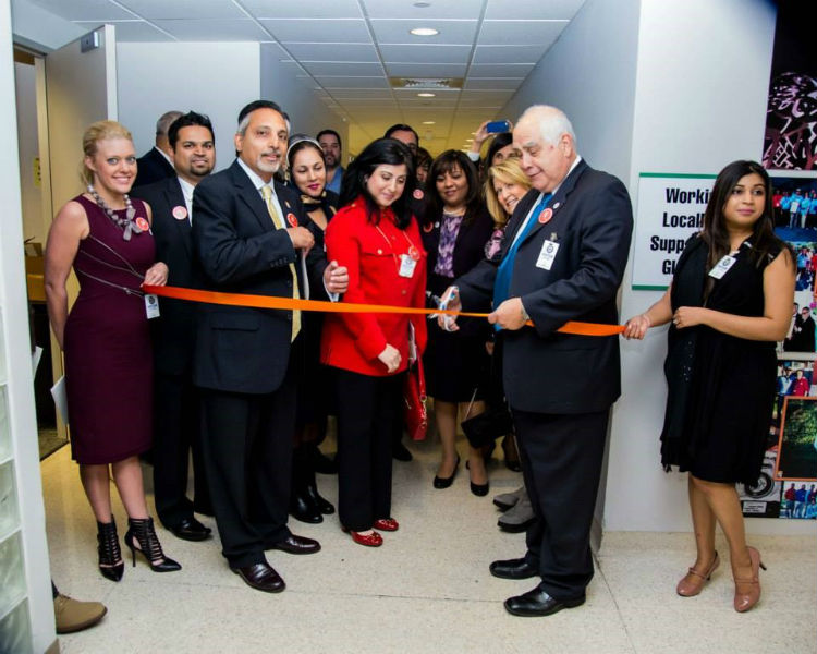 Dr. Flores cuts the ribbon at the AKF exhibit opening ceremony