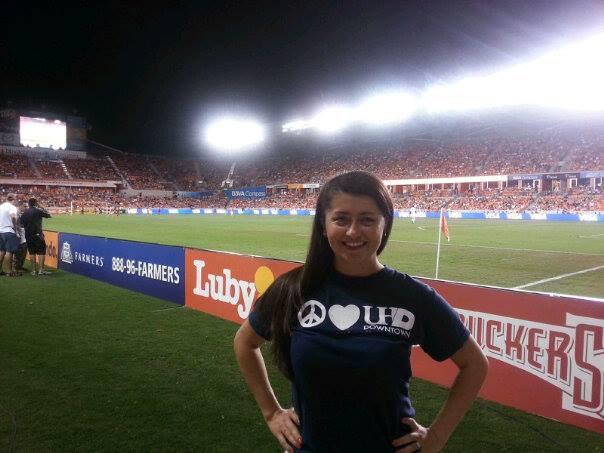 Grad student Angie Valencia wear a UHD shirt to a Houston Dynamo game where she received a scholarship from the Houston Women's Soccer Association.