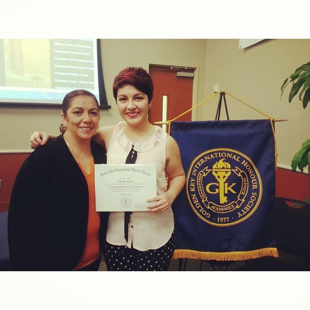 President Aracely Garcia, a junior political science major, poses with her mother at the UHD Golden Key International Honour Society chapter installation.