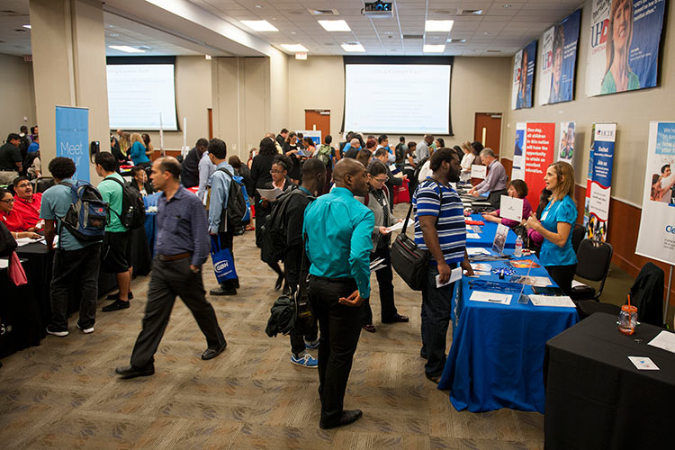 Hundreds of UHD students browse the fall 2014 career fair