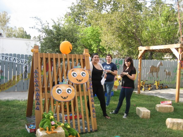 "UHD students prepare ""Pin the Nose on the Pumpkin"" at the House of Tiny Treasures in 2012."