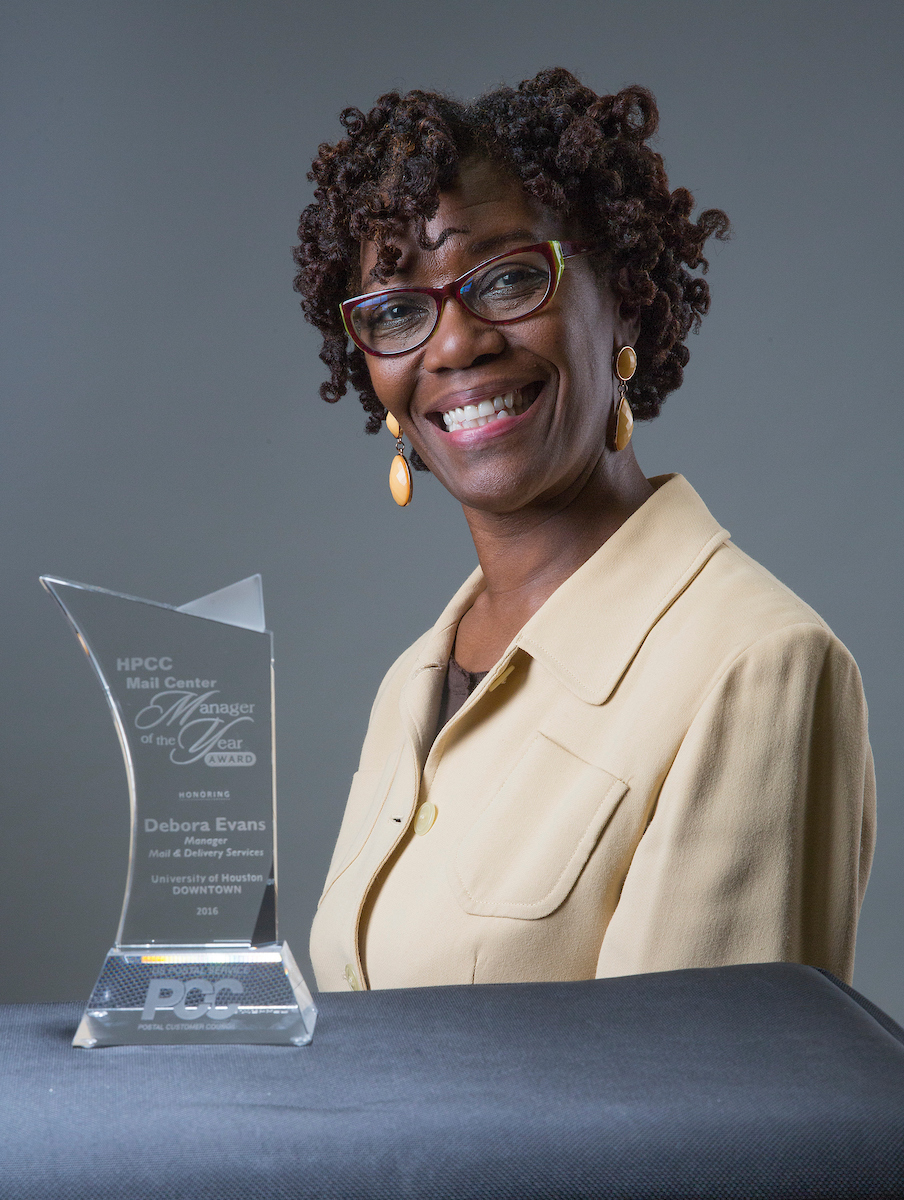 12/9/ 2016: UHD staff Deborah Evans poses with her HPCC Mail Center manger of the Year award at UHD in Houston, TX.