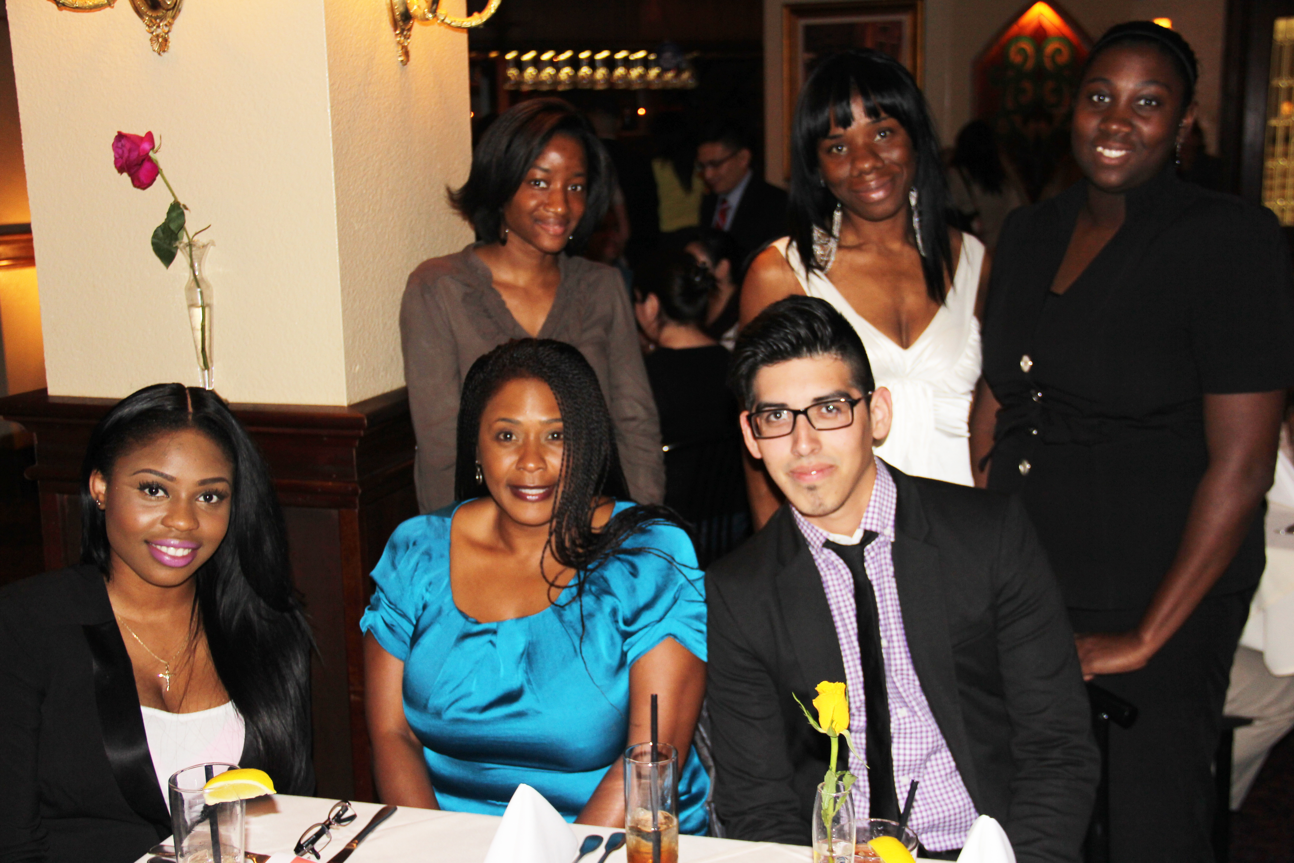 Business students receive tips on dining etiquette during the AMA dinner.