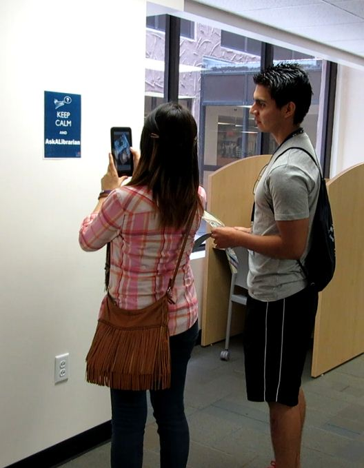 Summer Fast Track Institute students interact with one of the library's augmented reality objects.