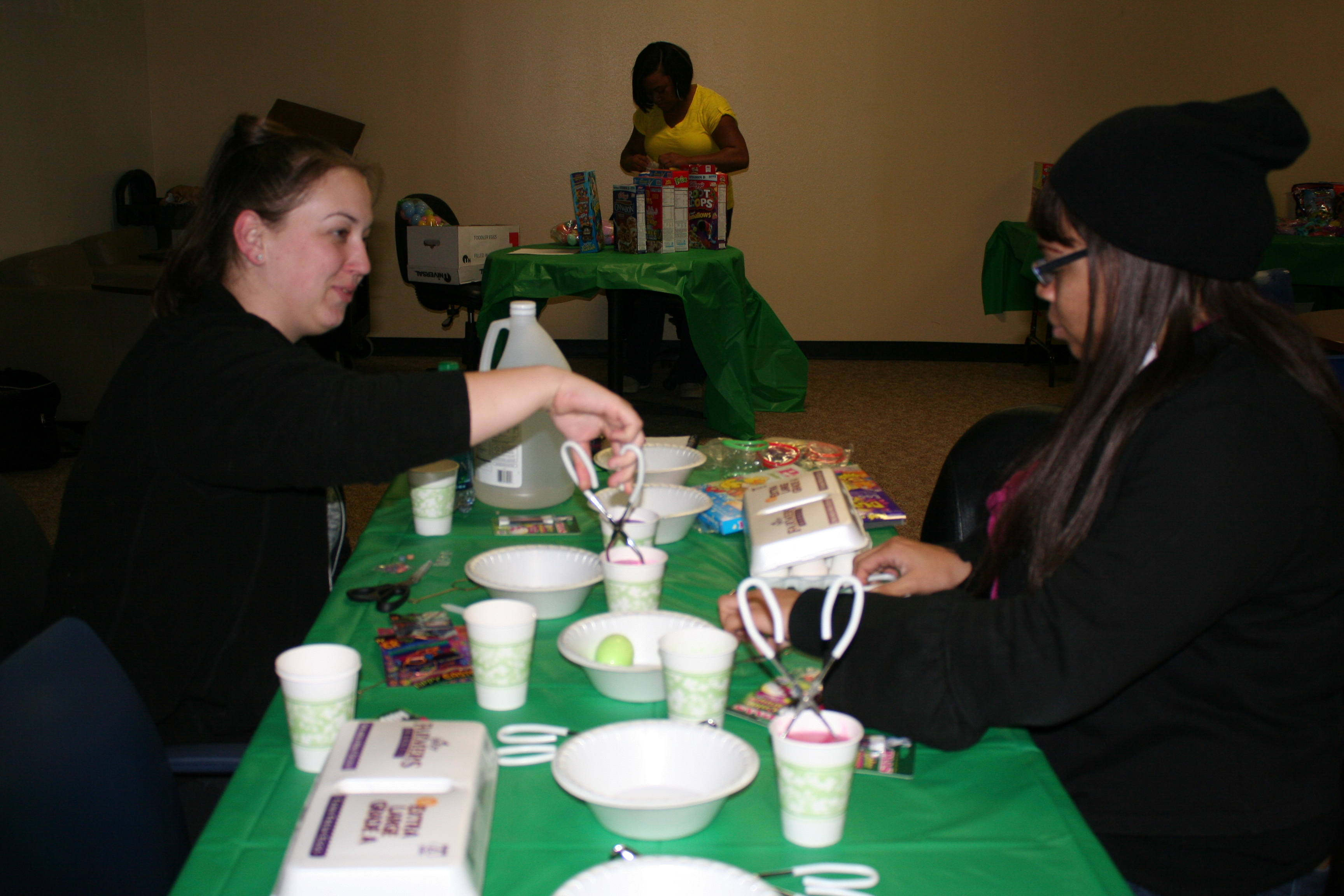 Students Candace Ruff (left) and Tenesha Montgomery (right) decorated eggs for the HTT spring festival.