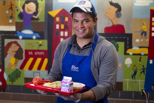 Courtesy of the Houston Chronicle. Juan Sorto volunteers to feed the homeless during his spare time.