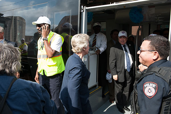 Mayor Anise Parker boards the light rail with President Flores during the Houston METRO 100 millionth rider celebration.