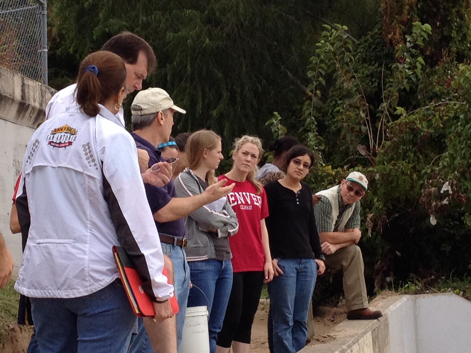 Associate Professor Brad Hoge works with teachers near th bayou during a training session in 2013.