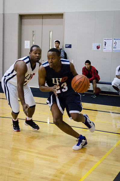 Alum Carl Williams, class of 2005, drives to the basket.