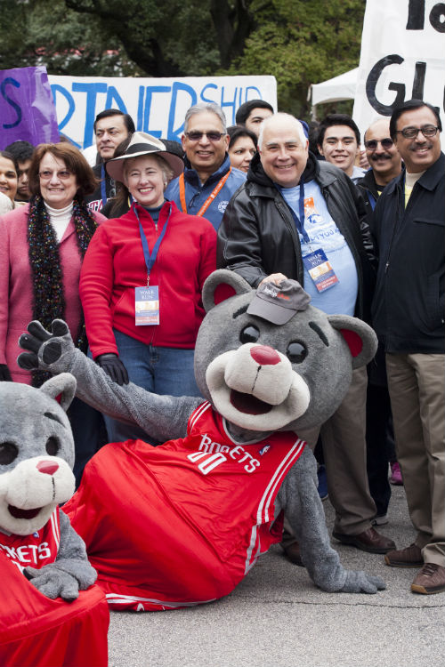 (left to right) Kathy Hubbard, Mayor Parker, and Dr. Flores pose with Houston Rockets mascots before setting out on the walk.